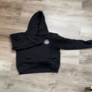Obey black hoodie slightly cropped length.